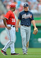 22 July 2012: Atlanta Braves third baseman Chipper Jones has a chat with 3rd base coach Bo Porter during a game against the Washington Nationals at Nationals Park in Washington, DC. The Braves fell to the Nationals 9-2 splitting their 4-game weekend series. Mandatory Credit: Ed Wolfstein Photo
