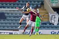 13th March 2021; Dens Park, Dundee, Scotland; Scottish Championship Football, Dundee FC versus Arbroath; Christie Elliott of Dundee challenges for the ball with Dale Hilson of Arbroath
