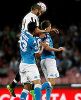 Calcio, Serie A: Napoli vs Juventus. Napoli, stadio San Paolo, 26 settembre 2015. <br /> Juventus' Giorgio Chiellini, center, and Napoli's Raul Albiol, left, and Jorginho jump for the ball during the Italian Serie A football match between Napoli and Juventus at Naple's San Paolo stadium, 26 September 2015.<br /> UPDATE IMAGES PRESS/Isabella Bonotto