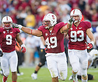 STANFORD, CA - September 21, 2013:  Stanford Cardinal defensive end Ben Gardner (49) celebrates his fumble recovery during the Stanford Cardinal vs the Arizona State Sun Devils at Stanford Stadium in Stanford, CA. Final score Stanford Cardinal 42, Arizona State Sun Devils 28.
