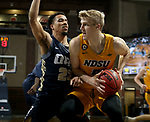 SIOUX FALLS, SD - MARCH 9: Sheldon Stevens #23 of the Oral Roberts Golden Eagles applies pressure to Sam Griesel #5 of the North Dakota State Bison during the 2021 Men's Summit League Basketball Championship at the Sanford Pentagon in Sioux Falls, SD. (Photo by Dave Eggen/Inertia)