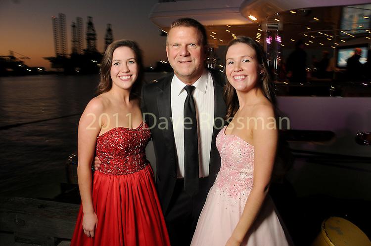 "Tilman Fertitta with Sarah Johnson and Anna Johnson at the San Luis Salute ""Space Pirates"" VIP reception Friday February 24,2017. (Dave Rossman Photo)"