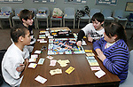 "THOMASTON, CT, 01/03/08- 010309BZ01- Clocwise from left- Jeffrey Thompson, 10, Steven Schriver, 13, David Schriver, 10, and Marisa Santopietro (CQ), 9, play Star Wars Monopoly during ""Game Day"" at the Thomaston Public Library Saturday.  Kids were welcome to bring their own games or use those at the library owns in an effort to expand programming for children of all ages.<br />  Jamison C. Bazinet Republican-American"
