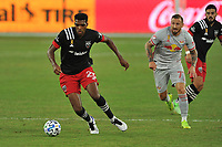 WASHINGTON, DC - SEPTEMBER 12: Donovan Pines #23 of D.C. United moves the ball battles for the ball with Daniel Royer #77 of New York Red Bulls during a game between New York Red Bulls and D.C. United at Audi Field on September 12, 2020 in Washington, DC.