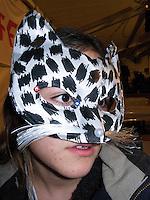 Switzerland. Canton Ticino. Montagnola. Micaela Ruef wears a carnival mask of a cat. MODEL RELEASED 13.02.09 © 2009 Didier Ruef