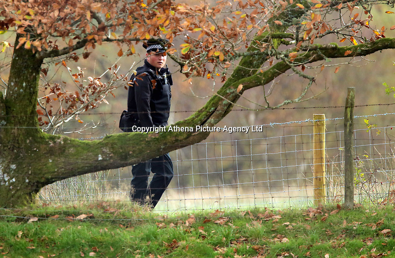 Pictured: A police officer at the the property in Llangammarch Wells, Powys, Wales, UK. Tuesday 31 October 2017<br /> Re: Investigations continue into a house fire in which a father and several of his children have died.<br /> Three children aged 13, 12 and 10 escaped the farmhouse in Llangammarch Wells, Powys, in the early hours of Monday and raised the alarm.<br /> Police said they could not identify the deceased or confirm numbers.<br /> One of those missing has been named locally as David Cuthbertson.