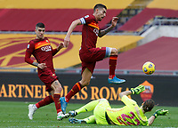 Roma's Lorenzo Pellegrini, center, past his teammate Gianluca Mancini, left, jumps over Genoa's goalkeeper Federico Marchetti during the Italian Serie A Football match between Roma and Genoa at Rome's Olympic stadium, March 7, 2021.<br /> UPDATE IMAGES PRESS/Riccardo De Luca