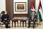 Palestinian President Mahmoud Abbas meets with Chairman of the Palestinian Central Election Committee Nasser Hanna, in the West Bank city of Ramallah, on January 15, 2021. Photo by Thaer Ganaim