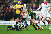 20121027 Copyright onEdition 2012©.Free for editorial use image, please credit: onEdition..Brad Barritt of Saracens is tackled by Ryan Lamb (left) and Phil Dowson of Northampton Saints during the Aviva Premiership match between Northampton Saints and Saracens at Franklin's Gardens on Saturday 27th October 2012 (Photo by Rob Munro)..For press contacts contact: Sam Feasey at brandRapport on M: +44 (0)7717 757114 E: SFeasey@brand-rapport.com..If you require a higher resolution image or you have any other onEdition photographic enquiries, please contact onEdition on 0845 900 2 900 or email info@onEdition.com.This image is copyright the onEdition 2012©..This image has been supplied by onEdition and must be credited onEdition. The author is asserting his full Moral rights in relation to the publication of this image. Rights for onward transmission of any image or file is not granted or implied. Changing or deleting Copyright information is illegal as specified in the Copyright, Design and Patents Act 1988. If you are in any way unsure of your right to publish this image please contact onEdition on 0845 900 2 900 or email info@onEdition.com