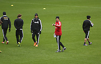 Wednesday 05 February 2014<br /> Pictured: Garry Monk (in red) speaking to his players<br /> Re: Swansea City FC training with Garry Monk as head coach after the departure of Michael Laudrup, at the Li Liberty Stadium, south Wales.