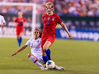 PHILADELPHIA, PA - AUGUST 29: Raquel Infante #3 of Portugal tackles Sam Mewis #3 of the United States dribbles during a game between Portugal and the USWNT at Lincoln Financial Field on August 29, 2019 in Philadelphia, PA.