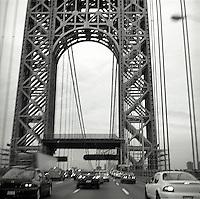 Car traffic passing under the George Washington Bridge<br />