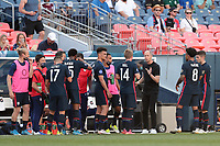 DENVER, CO - JUNE 3: USMNT head coach Gregg Berhalter talks with Jackson Yueill #14 during a game between Honduras and USMNT at Empower Field at Mile High on June 3, 2021 in Denver, Colorado.