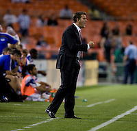 D.C. United head coach Curt Onalfo yells to his team at RFK Stadium in Washington, DC.  D.C. United defeated the Kansas City Wizards, 2-1.