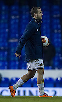 12.12.2013 London, England. Tottenham Hotspur forward Roberto Soldado (9) collects the match ball after scoring a hat trick  during the Europa League game between Tottenham Hotspur and Anzhi Makhachkala from White Hart Lane.