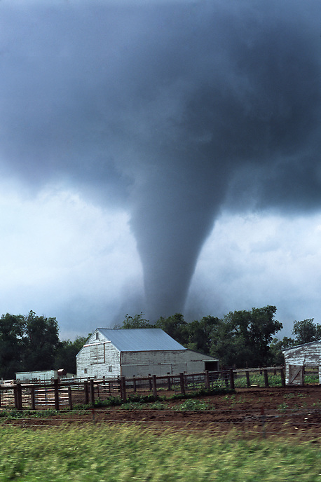 A strong tornado churns toward a farmstead near Woonsocket South Dakota on June 24th, 2003. This storm was part of a weather system that spawned the largest single-day outbreak of tornadoes in the state's history.