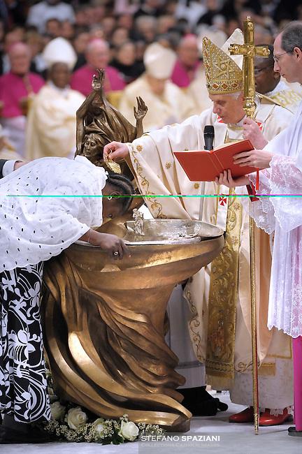 Pope Benedict XVI baptises as he celebrates a Easter Vigil mass in Saint Peter's Basilica at the Vatican 03 April 2010.