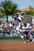 Baltimore Orioles second baseman Jonathan Schoop (6) throws to first on a double play as Will Middlebrooks (16) slides in during a spring training game against the Boston Red Sox on March 8, 2014 at Ed Smith Stadium in Sarasota, Florida.  Baltimore defeated Boston 7-3.  (Mike Janes/Four Seam Images)