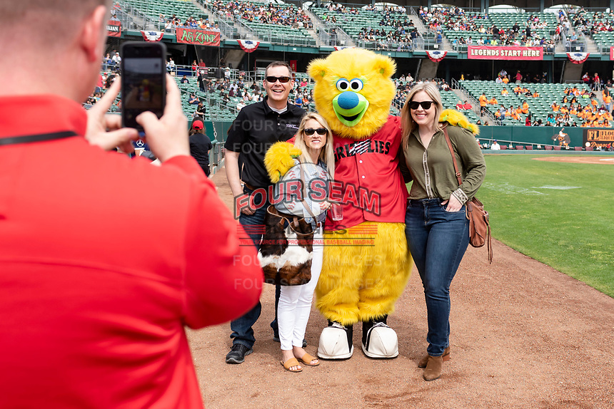 Fresno Grizzlies Mascot, Parker, poses for a photo with fans before a game against the Reno Aces at Chukchansi Park on April 8, 2019 in Fresno, California. (Zachary Lucy/Four Seam Images)