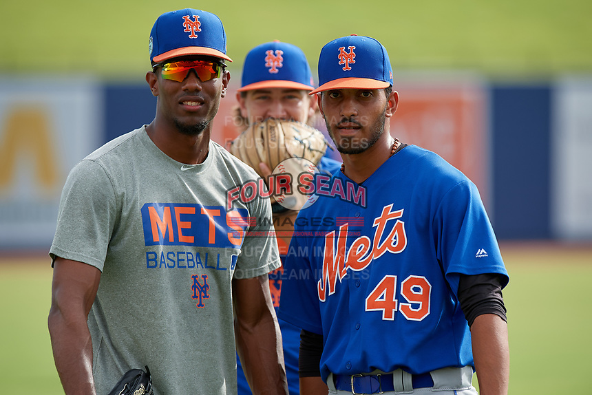GCL Mets pitchers Julian Sierra (left) and Eric Villanueva (49) pose for a photo as Nate Peden photo bombs before the first game of a doubleheader against the GCL Nationals on July 22, 2017 at The Ballpark of the Palm Beaches in Palm Beach, Florida.  GCL Mets defeated the GCL Nationals 1-0 in a seven inning game that originally started on July 17th.  (Mike Janes/Four Seam Images)