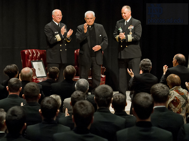 Apr. 17, 2013; President Emeritus Rev. Theodore M. Hesburgh, C.S.C. blesses the Notre Dame Naval ROTC Battalion of Midshipmen after being named an honorary Navy Chaplain by Rear Adm. Mark L. Tidd, left, Chief of Navy Chaplains and Capt. Clarence Earl Carter, Commanding Officer, Naval ROTC in the Carey Auditorium in Hesburgh Library...Photo by Matt Cashore/University of Notre Dame