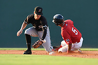 Second baseman Zach Remillard (8) of the Kannapolis Intimidators takes a late throw as Lorenzo Cedrola (5) of the Greenville Drive slides safely into second in a game on Friday, July 14, 2017, at Fluor Field at the West End in Greenville, South Carolina. Greenville won, 2-0. (Tom Priddy/Four Seam Images)