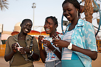 Teenagers enjoy ice cream outside the Afra mall. Khartoum's first mall 'Afra' opened in 2004 and has become popular with affluent Sudanese.