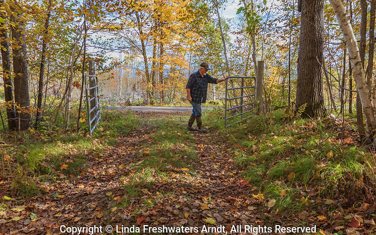 Gate leading to a private woodland trail in northern Wisconsin.
