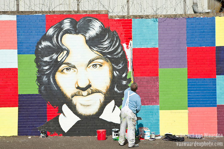 Muralist Sean McVeigh Paints the a portrait of hunger striker Frances Hughes on the Falls Road.