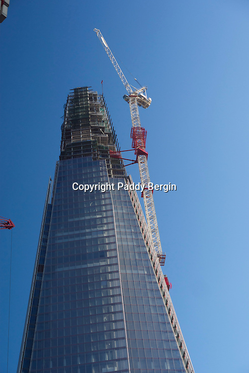 """Emporis Skyscraper Award judges said of The Shard: """"A Skyscraper that is recognised immediately and which is already considered London's new emblem""""<br /> <br /> Irvine Sellar, The Shard's developer and joint owner approached architect Renzo Piano and he made a sketch on a menu of his idea and Sellar agreed to his """"design"""".<br /> <br /> Sellar said of the Shard: """"The vision for the Shard was to create an architecturally striking vertical city incorporating retail, offices, hotel, apartments, restaurants and a public viewing gallery.""""<br /> <br /> His Excellency Sheikh Abdullah Bin Saoud Al Thani<br /> Governor of Qatar Central Bank said of The Shard at its opening in July 2012:<br /> <br /> """"Standing 95 storeys tall at almost 310 metres, the Shard will be one of the tallest buildings in Western Europe.""""<br /> <br /> A million people visited the Shard's viewing platform in its first year.<br /> <br /> Taking inspiration from the spires of London churches and the masts of tall ships depicted by the 18th-century Venetian painter Canaletto, architect Renzo Piano designed The Shard as a spire-like sculpture emerging from the River Thames. <br /> <br /> It is situated on the South Bank of the Thames next to London Bridge Station and close to the very popular Borough Market. <br /> <br /> Stock Photo by Paddy Bergin."""