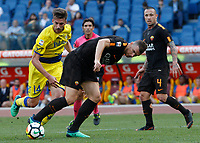 Roma s Edin Dzeko, right, is challenged by Chievo Verona s Mattia Bani, during the Italian Serie A football match between Roma and Chievo Verona at Rome's Olympic stadium, 28 April 2018.<br /> UPDATE IMAGES PRESS/Riccardo De Luca