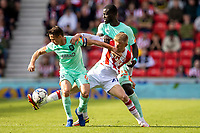 11th September 2021;  Bet365 Stadium, Stoke, Staffordshire, England; EFL Championship football, Stoke City versus Huddersfield Town; Sam Surridge of Stoke City is tackled by Naby Sarr and Jonathan Hogg  of Huddersfield Town