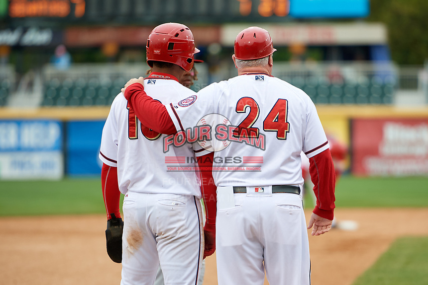 Harrisburg Senators left fielder Juan Soto (10) with manager Matthew LeCroy (24) at third base during the first game of a doubleheader against the New Hampshire Fisher Cats on May 13, 2018 at FNB Field in Harrisburg, Pennsylvania.  New Hampshire defeated Harrisburg 6-1.  (Mike Janes/Four Seam Images)