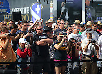 Feb 20, 2015; Chandler, AZ, USA; Fans look on as NHRA top fuel driver Leah Pritchett warms up in her pit during qualifying for the Carquest Nationals at Wild Horse Pass Motorsports Park. Mandatory Credit: Mark J. Rebilas-