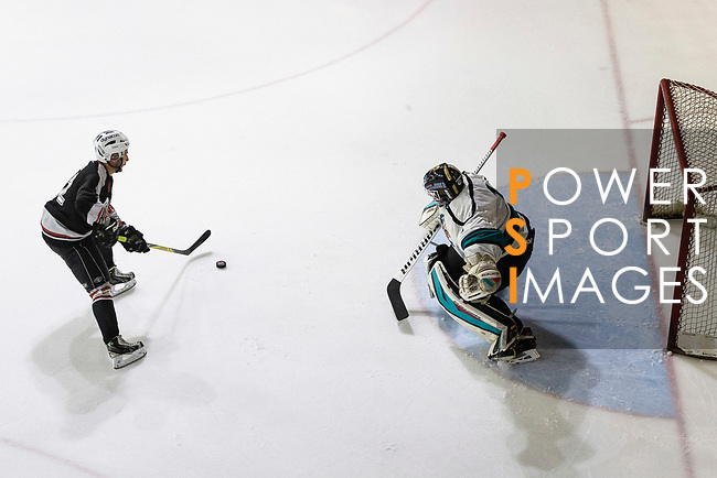 Patrick Ruiz of Nordic Vikings (L) battle in the goal mouth with Cathay Flyers Goalie Jasen Await (R) during the Mega Ice Hockey 5s match between Cathay Flyers and Nordic Vikings on May 03, 2018 in Hong Kong, Hong Kong. Photo by Marcio Rodrigo Machado / Power Sport Images