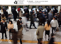 Shinjuku JR train station during peak hours in Tokyo, Japan. Shinjuku is the busiest railway station in the world with several million comuters passing through daily.<br />