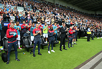 Swansea manager Paul Clement (4th L) applauds in tribute to honorary president of Swansea Gwilym Joseph before the English Premier League soccer match between Swansea City and Manchester United at Liberty Stadium, Swansea, Wales, UK. Saturday 18 August 2017