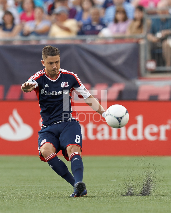 New England Revolution defender Chris Tierney (8) passes the ball. In a Major League Soccer (MLS) match, the New England Revolution tied the Seattle Sounders FC, 2-2, at Gillette Stadium on June 30, 2012.
