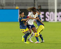 ORLANDO, FL - JANUARY 22: Catarina Macario #29 tries to split two opponents during a game between Colombia and USWNT at Exploria stadium on January 22, 2021 in Orlando, Florida.