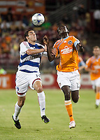 FC Dallas defender George John (14) and Houston Dynamo forward Kei Kamara (10) try to get a head on the ball.  Houston Dynamo defeated FC Dallas 1-0 at Robertson Stadium in Houston, TX on May 9, 2009
