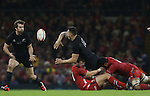 All Blacks centre Sonny Bill Williams finds Conrad Smith in support as he's tackles by Wales pair Dan Biggar and 'Taulupe Faletau.<br /> Dove men Series 2014<br /> Wales v New Zealand<br /> 22.11.14<br /> ©Steve Pope -SPORTINGWALES
