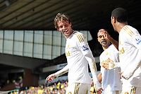 Pictured L-R: Michu of Swansea celebrating his opening goa with team mates Luke Moore and Jonathan de Guzman.  Saturday 06 April 2013<br /> Re: Barclay's Premier League, Norwich City FC v Swansea City FC at the Carrow Road Stadium, Norwich, England.
