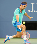 Roger Federer (SUI) comes back strong after a rain delay to beat Marcel Granollers (ESP) 406, 6-1, 6-1, 6-1 at the US Open being played at USTA Billie Jean King National Tennis Center in Flushing, NY on August 31, 2014