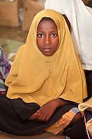 Zanzibar, Tanzania.  Young Boy in Madrassa (Koranic School).