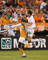 New York Red Bulls defender Kevin Goldthwaite (2) deflects the ball away from Houston Dynamo forward Kei Kamara (10).  Houston Dynamo tied New York Red Bulls 0-0 at Robertson Stadium in Houston, TX onApril 11, 2009.