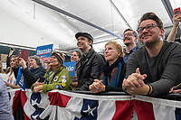 People listen as Democratic presidential candidate and Vermont senator Bernie Sanders speaks at a campaign event at Hampshire Hills Athletic Club in Milford, New Hampshire, on Tue., Feb. 4, 2020. The  event started around 7pm and was the first event Sanders held after the previous day's Iowa Caucuses. The results of the caucuses were unknown until the Democratic party released partial numbers at 5pm, showing Sanders and former South Bend, Ind., mayor Pete Buttigieg both as frontrunners.