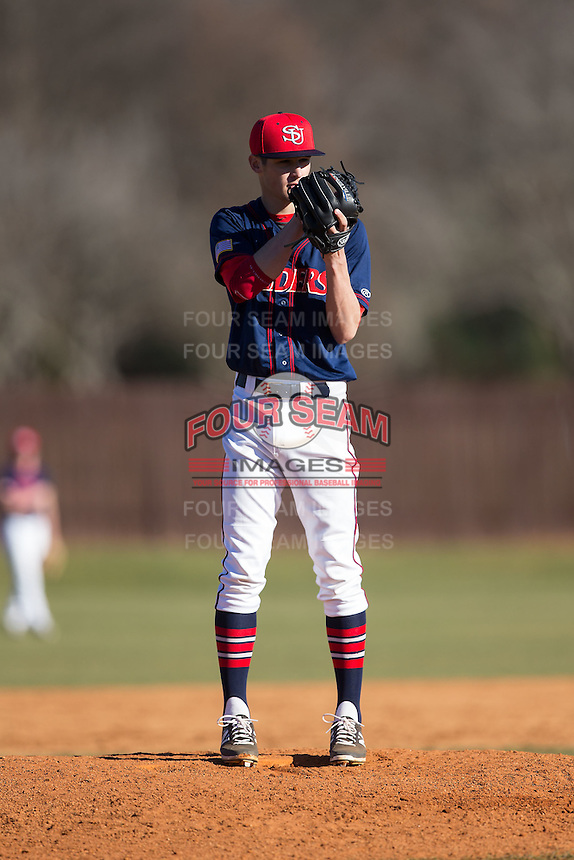 Shippensburg Raiders relief pitcher Gabe Mosser (8) looks to his catcher for the sign against the Belmont Abbey Crusaders at Abbey Yard on February 8, 2015 in Belmont, North Carolina.  The Raiders defeated the Crusaders 14-0.  (Brian Westerholt/Four Seam Images)