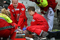 A doctor and a rescue professional performing CPR on man with heart failiure. Pictures of Norwegian Air Ambulance at work, operating out of Trondheim. The helicopter crew consist of a pilot, a crew member/rescue professional, and a physician. Siv Moen