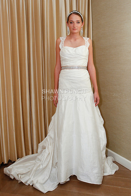Model poses in an Emma wedding gown from the Pixton Couture Bridal Spring 2014 collection, by Kimberly Pixton Millar, during New York Bridal Market Week Spring 2014.