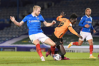 Jack Whatmough of Portsmouth left fouls Daniel Agyei of Oxford United for a penalty during Portsmouth vs Oxford United, Sky Bet EFL League 1 Football at Fratton Park on 24th November 2020
